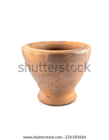 earthenware produced a Stone mortar isolated on white background - stock photo