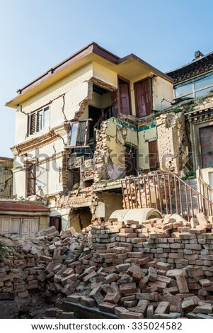 Earthwuake ruins of a house. Collapsed building Kathmandu. - stock photo
