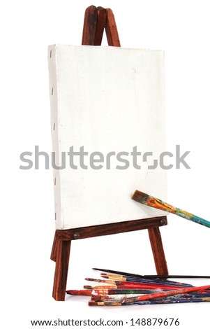 Easel and pain brushes - stock photo