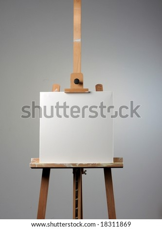 easel and white canvas - stock photo
