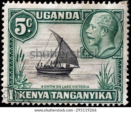 EAST AFRICAN COMMUNITY - CIRCA MAY, 1935: A stamp printed by EAST AFRICAN COMMUNITY shows portrait of King George V against traditional sailing vessel Dhow on Lake Victoria - stock photo