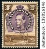 EAST AFRICAN POSTAL UNION - CIRCA 1952: A stamp printed in East African postal Union (Kenya, Uganda, Tanganyika) shows portrait of King George VI and Jinja bridge by the ripon falls, circa 1952 - stock photo