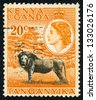 EAST AFRICAN POSTAL UNION - CIRCA 1954: A stamp printed in East African postal Union (Kenya, Uganda, Tanganyika) shows African Leo (Panthera leo), circa 1954 - stock photo