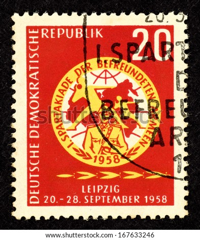 EAST GERMANY - CIRCA 1958: Stamp printed in East Germany with image of Communist Spartakiads games crest, circa 1958.