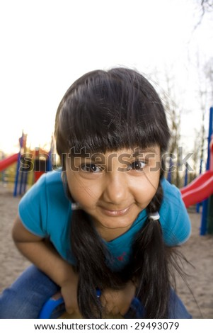 East Indian Girl Playing at playground
