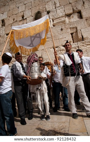 EAST JERUSALEM, OCCUPIED PALESTINIAN TERRITORIES - OCTOBER 31: Jewish worshipers gather for a Bar Mitzvah at the Western Wall, the holiest site in Judaism on Oct. 31, 2011. - stock photo