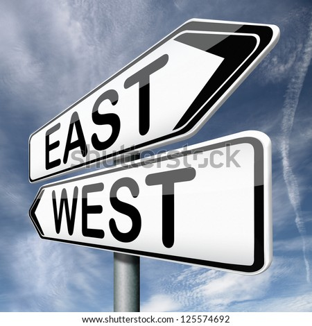 east or west compass opposite directions - stock photo