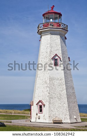East Point Lighthouse is located at the far eastern end of Prince Edward Island, Canada. - stock photo