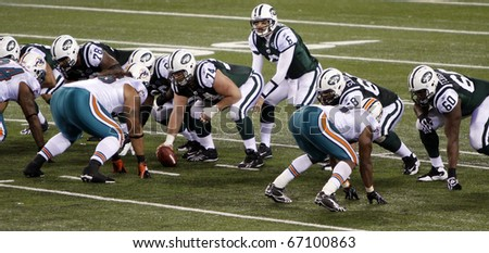 EAST RUTHERFORD - DECEMBER 12: New York Jets quarterback Mark Sanchez calls out a play against the Miami Dolphins at Meadowlands Stadium on December 12, 2010 in East Rutherford, NJ.