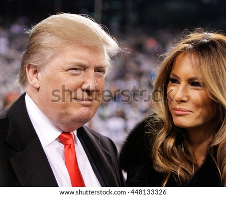 EAST RUTHERFORD, NJ-NOV 13: Donald Trump and wife Melania Trump before a football game at MetLife Stadium on November 13, 2011 in East Rutherford, New Jersey.  - stock photo