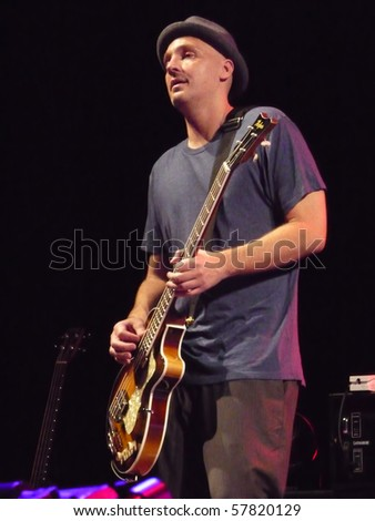 EAST TROY, WI - JUL. 24: Bassist Merlo Podlewski (Jack Johnson) performs during their 2010 To The Sea tour in East Troy, Wisconsin at Alpine Valley Music Theater on July 24, 2010 in East Troy, MI. - stock photo
