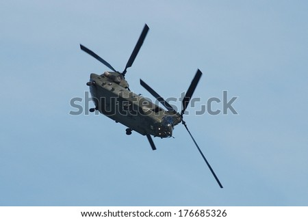 EASTBOURNE, ENGLAND - AUGUST 11, 2012: A Boeing Chinook HC2 helicopter of the Royal Air Force performs at the Airbourne airshow. Outside of the US army the RAF operate the largest fleet of Chinooks. - stock photo