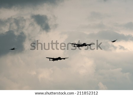 EASTBOURNE, ENGLAND - AUGUST 15: The Battle of Britain Memorial Flight - Avro Lancasters PA 474 and KB726, Spitfire and Hurricane fly at the Eastbourne Airshow, Airbourne on August 15, 2014