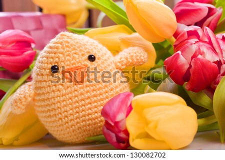 easter and spring decoration with chick and tulip flowers - stock photo