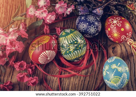 Easter background. colored Easter eggs and composition of dried flowers and plants. on wooden background. easter theme. happy easter. instagram toning effect - stock photo