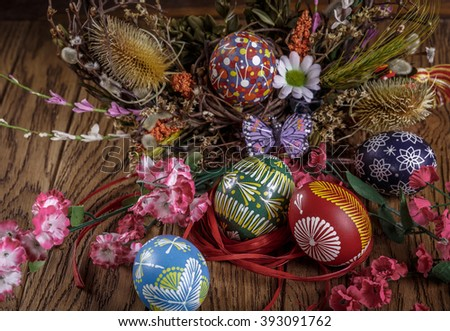 Easter background. colored Easter eggs and composition of dried flowers and plants. on wooden background. easter theme. happy easter