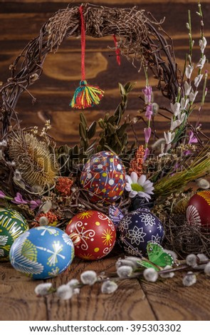 Easter background. colored Easter eggs in the nest and composition of dried flowers and plants. on wooden background. easter theme. happy easter. - stock photo