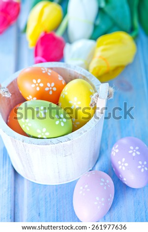easter background, easter eggs and flowers on a table