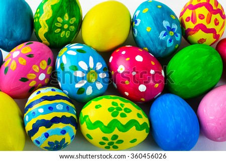 Easter background of hand-painted multicolored Easter eggs. Easter symbol. Top view with copy space - stock photo