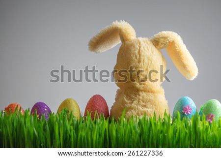 easter background with bunny and eggs - stock photo