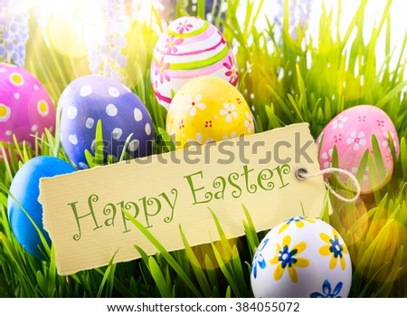 Easter Background with easter eggs and spring flowers - stock photo