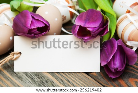 easter background with easter eggs, ribbon and flowers - stock photo