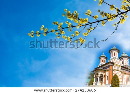 Easter Background with vibrant Spring yellow blossom and church - stock photo