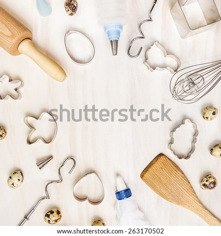 Easter bake background with quail eggs and biscuit cutter on white wooden table, top view, circle frame  - stock photo