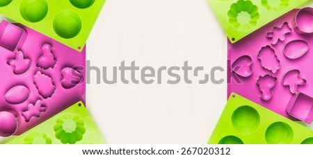 Easter bake tools with cookie cutter and cake mould on white wooden background,banner for website, top view - stock photo