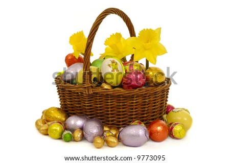 Easter basket with eggs and flowers. Taken on a  white background. - stock photo