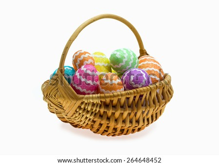 Easter basket with eggs over white background