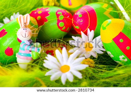 Easter bunny and colorful painted eggs - stock photo