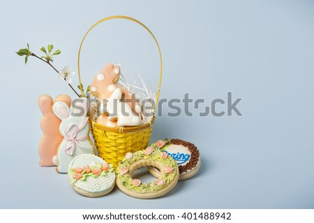 Easter bunny cakes on a blue background of the center shifted to the left - stock photo