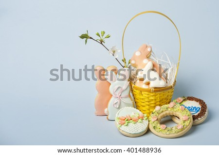 Easter bunny cakes on a blue background of the center shifted to the right - stock photo