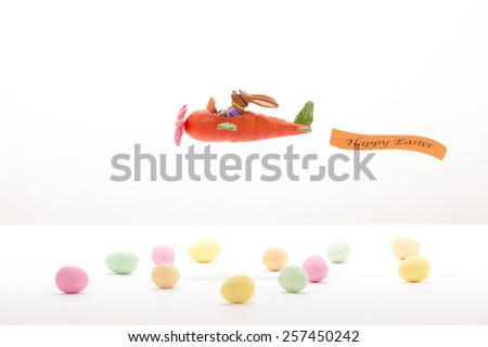 """Easter-bunny in a """"Carrot-airplane"""" - stock photo"""