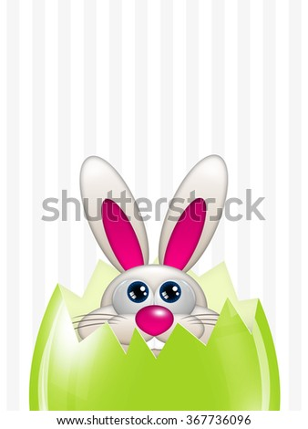 easter bunny looking up in green spring egg over striped background