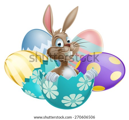 Easter Bunny rabbit with chocolate Easter Eggs - stock photo