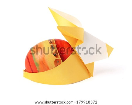 Easter bunny rabbit with painted egg on a white background - stock photo