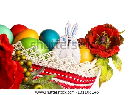 Easter bunny with poppies and colourful eggs isolated on white (clipping path included) - stock photo
