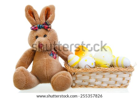 easter bunny with some eggs isolated on white - stock photo