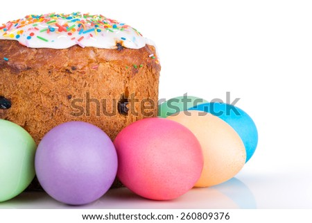 Easter cake and painted eggs closeup on white background