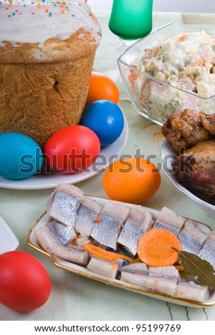 Easter cake, eggs and snacks on a festive table