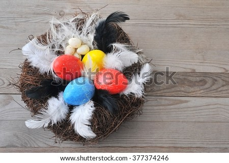 Easter card with eggs in nest on wood board.  Holiday background,
