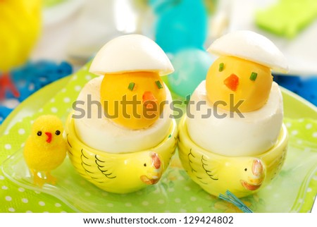 easter chickens made from hard boiled eggs as funny breakfast for child - stock photo