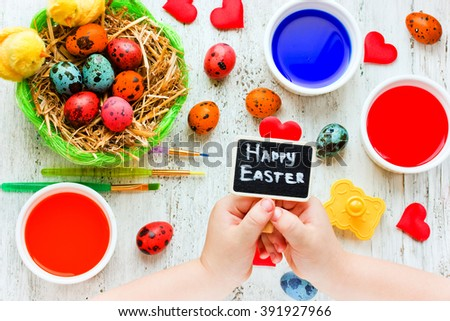 Easter children homemade crafts - colorful easter eggs dyeing colored paints. Beautiful Easter background - stock photo