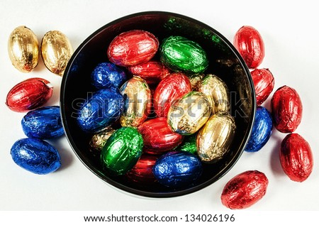 Easter chocolate eggs in a black bowl - stock photo