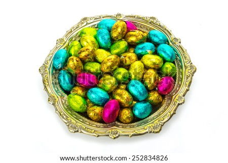 Easter chocolate eggs in a bowl on white background - stock photo