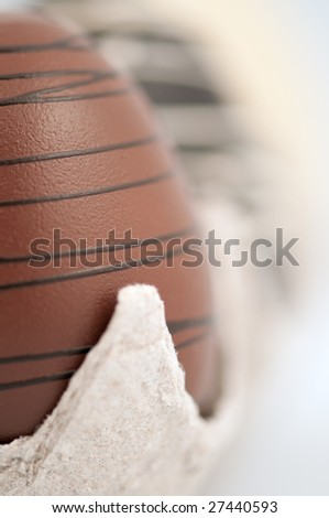 Easter chocolate eggs in a cardboard crate