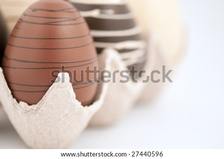 Easter chocolate eggs in a cardboard crate - stock photo