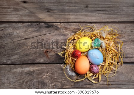 Easter color eggs on old wooden table - stock photo
